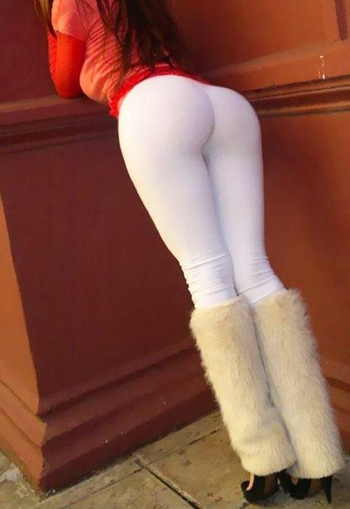 Girl bent over in shiny yoga pants